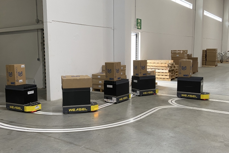 Escubedo's factory and warehouse connected with SSI Schaefer's Weasel® robots